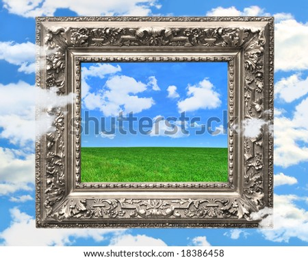 Silver picture frame against a blue sky with puffy clouds - stock photo
