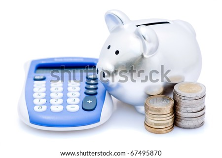 Silver piggy bank with pile of Euro coins and electronic calculator, isolated on white background