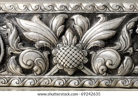 Silver plate engraving flower Northern Thai craftsmanship. - stock photo