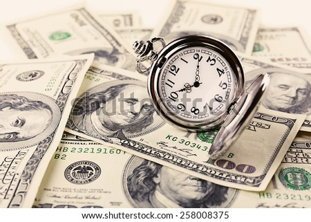 Silver pocket clock and money close-up. Time is money concept - stock photo