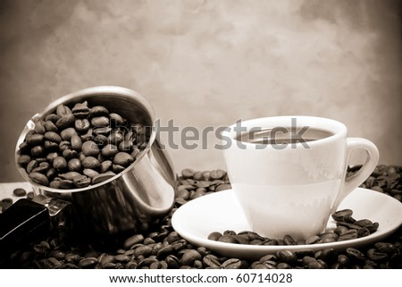 silver pot and cup of coffee - stock photo