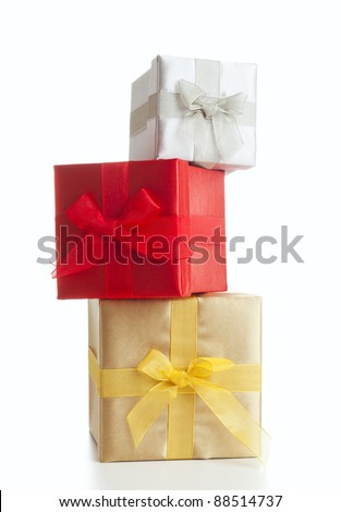 silver red and gold gift boxes stacked, isolated on white - stock photo