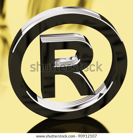 Silver Registered Sign With Gold Background Representing Patented Brands - stock photo