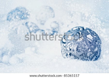 Silver rustical Christmas ornament baubles in the snow. Vintage holiday Christmas card - stock photo