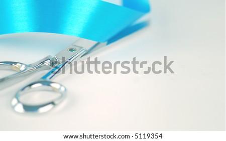 Silver Scissors Cutting Blue Ribbon - stock photo