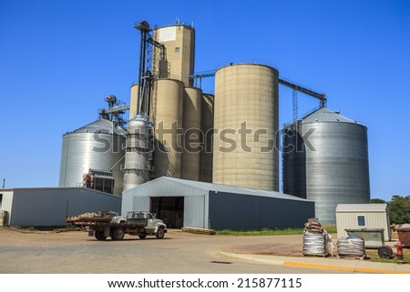 Silver, shiny agricultural silos - stock photo