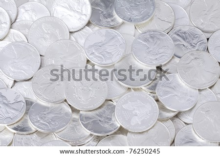 Silver shiny one dollar coins, money background - stock photo