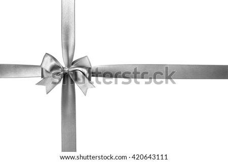 Silver silk ribbon with beautiful bow isolated on white background - stock photo