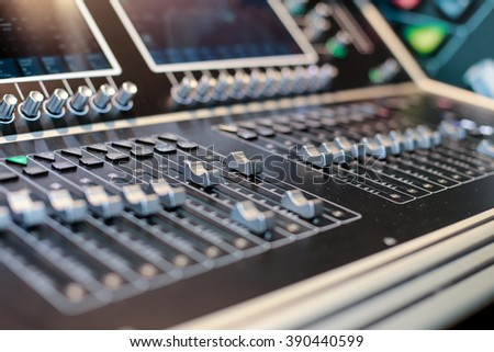 Silver sliders of the stage controller with screen - closeup background