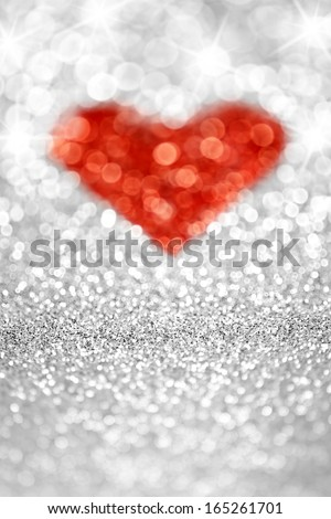 Silver sparkling glitter red heart background - stock photo