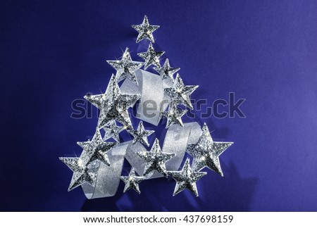 Silver sparkling Stars and Silver Ribbon over plain background - stock photo