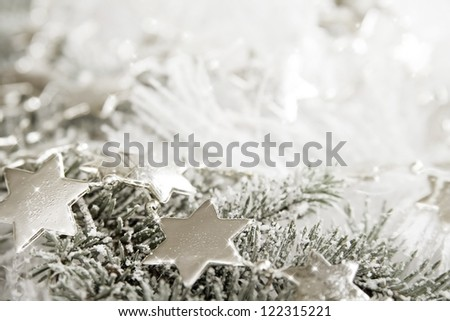 Silver sparkling stars on a white glistening background - stock photo