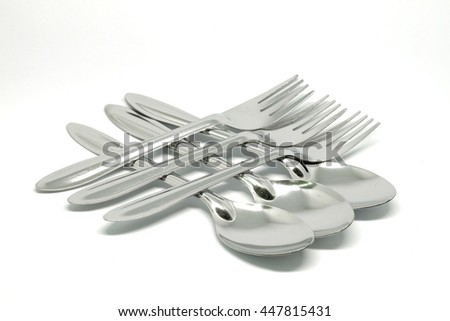 Silver spoon and fork  on clean background.