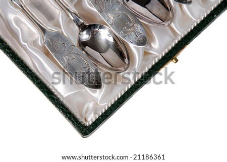 Silver spoons on satin