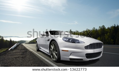 silver sports car with blue sky
