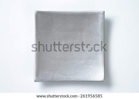 silver square plate on white background - stock photo