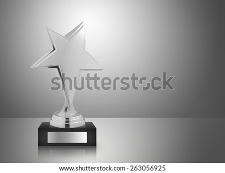 Silver star trophy on gray background - stock photo