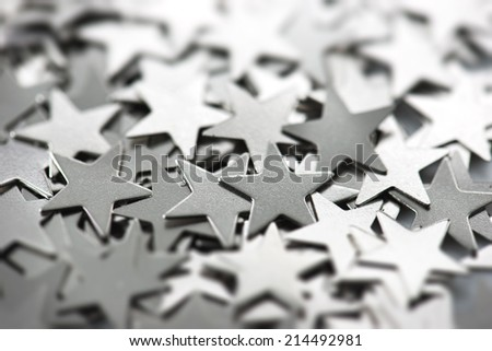 Silver stars. Silver metal stars scattered with reflective light. - stock photo