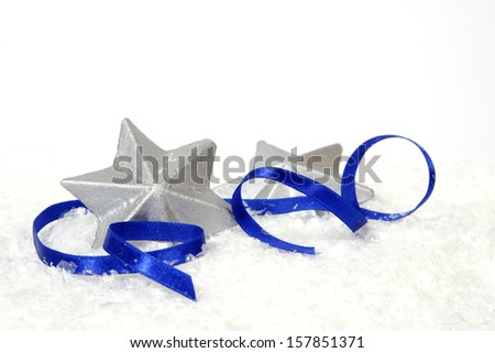 Silver stars with the blue ribbon on the white background - stock photo