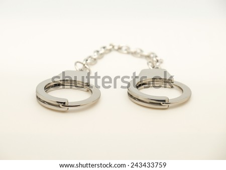 Silver steel handcuffs for arresting criminals and put to jail as isolated object on white background  - stock photo