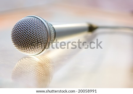 Silver steel microphone lying on the table