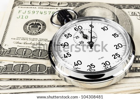 silver stopwatch closeup 5 sec on a pile of hundred dollar bills - stock photo