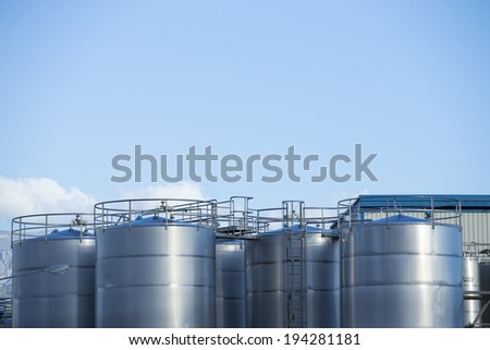 Silver storage tanks - stock photo