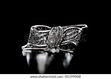 Silver stylish filigree isolated on black background - stock photo
