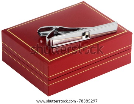 Silver  tie-pin on red box isolated on white