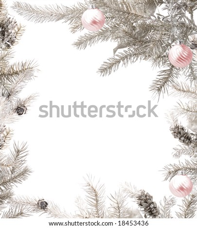 Silver tree branches arranged with glass baubles framing the picture - stock photo