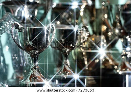 Silver Trophies glisten in the light - stock photo
