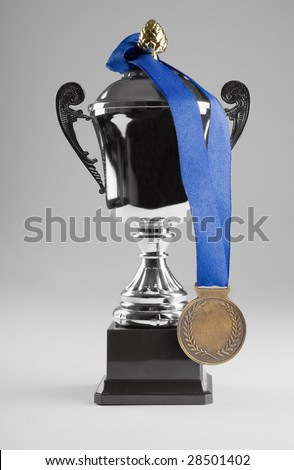 Silver trophy with medal on blue ribbon - stock photo
