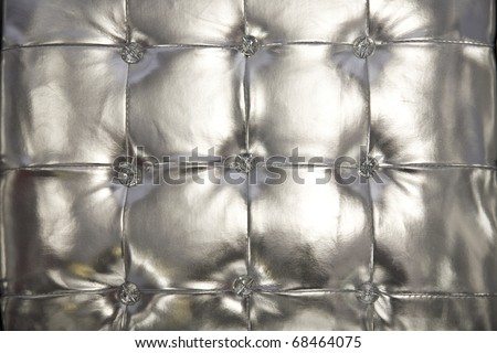 Silver tufted vinyl background for a trendy look - stock photo