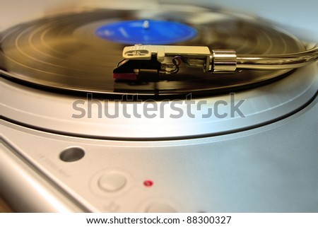 silver turntable and arm for music vinyl records - stock photo