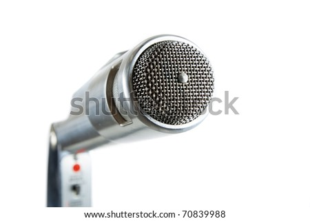 Silver Vintage Microphone on White. Close up. Side View. Mic is really close to the camera.
