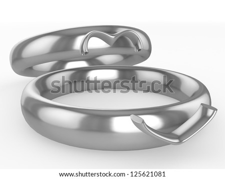 Silver wedding rings. Heart from two parts. Eternal love concept - stock photo