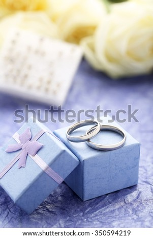 Silver wedding rings on a purple paper background - stock photo