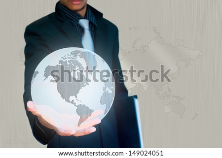 silver world in hand business background - stock photo