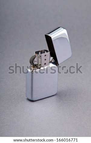 silver zippo lighter isolated on gray background