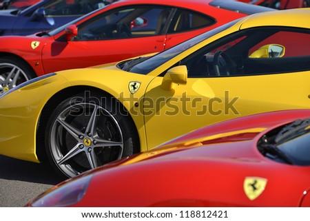 SILVERSTONE, UNITED KINGDOM- SEPTEMBER 17 2012:  A world record 964 Ferrari Cars Parade Around Silverstone F1 circuit . Silverstone September 17, 2012 in Silverstone, United Kingdom. - stock photo