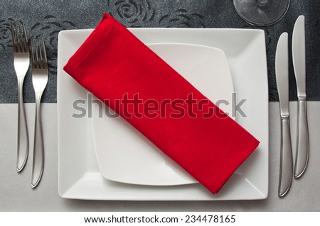 silverware closeup on red napkin - stock photo