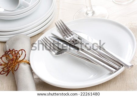 silverware on white plate and napkin