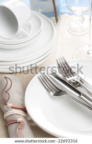 silverware on white plate and napkin - stock photo