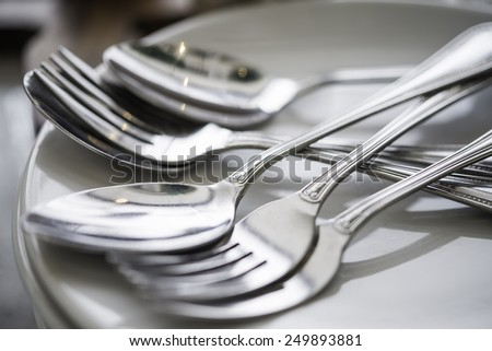 Silverware or flatware set and plates. on table dinner