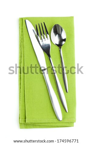 Silverware or flatware set of fork, spoon and knife on towel. Isolated on white background - stock photo