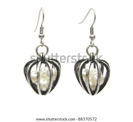 silvery earrings with pearl isolated on white background