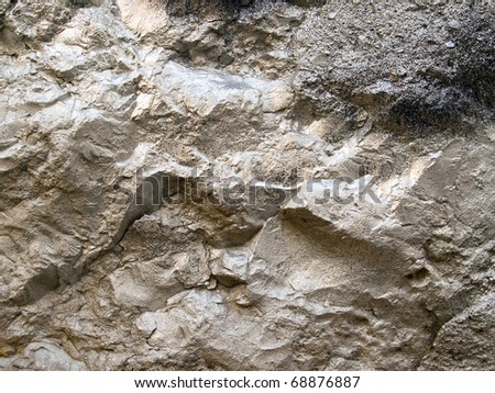 Silvery rock texture closeup background. - stock photo