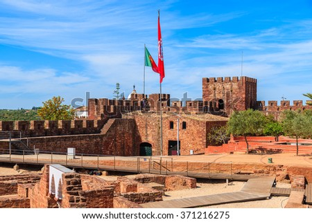 SILVES CASTLE, PORTUGAL - MAY 17, 2015: square of medieval castle in Silves town, Algarve region, Portugal. This town has best preserved ruins of castle in whole Algarve region. - stock photo