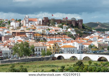 SILVES, PORTUGAL - APRIL 11, 2016 - Silves town buildings with famous castle and cathedral, Algarve region, Portuga - stock photo