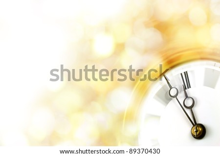 Silvester - light golden blurry background with vintage clock nearly before midnight - new year